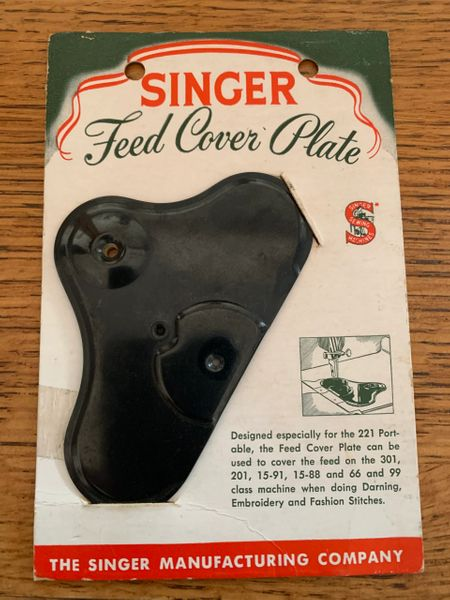 An amoeba feed cover plate in its package