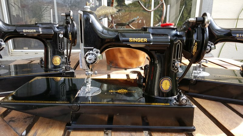 A close-up view of three black sewing machines