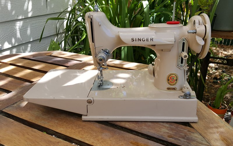 A white sewing machine outdoors