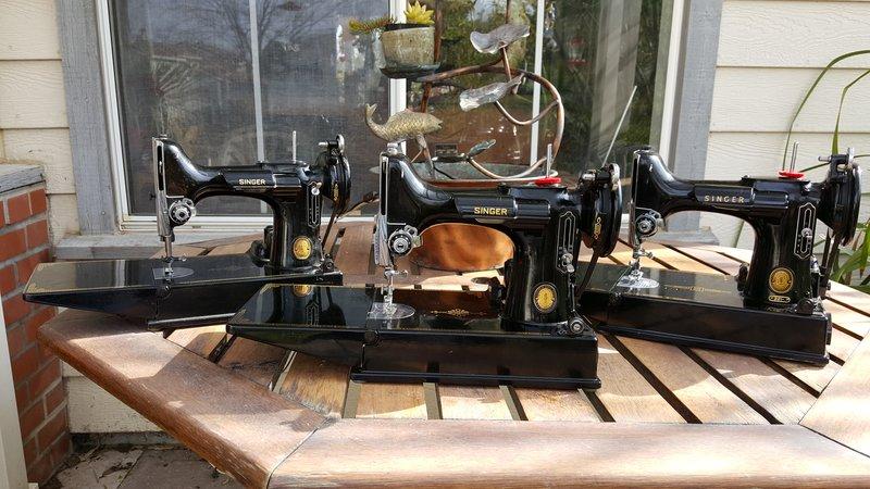 Three black sewing machines