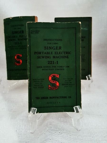 Three instruction books for electric sewing machine use