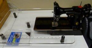 A clear extension table for the sewing machine