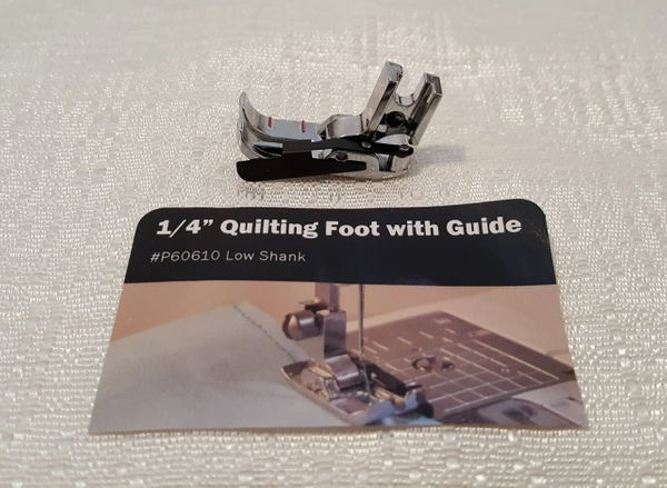 A quilting foot with a guide